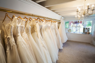 Rows of wedding dresses on display in a specialist wedding dress shop. Bridal Boutique.の写真素材 [FYI02258454]