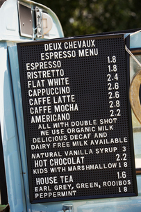 Price list for hot drinks on a blue mobile coffee shop.の写真素材 [FYI02259288]