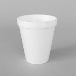 A white styrofoam cup on a grey background.の写真素材 [FYI02259363]