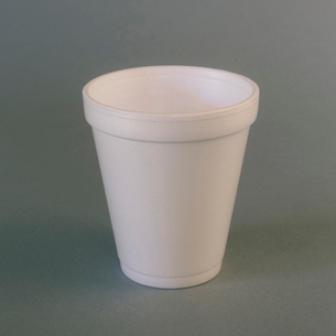 A white styrofoam cup on a grey background.の写真素材 [FYI02259508]
