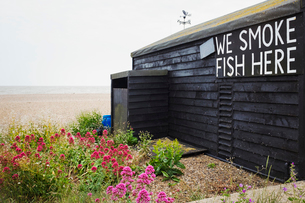 Exterior view of brown wooden fish shop on Suffolk coast.の写真素材 [FYI02259563]