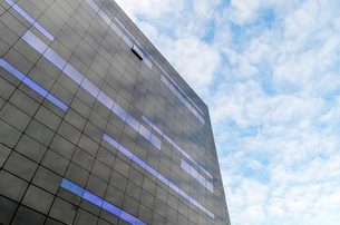 Low angle exterior view of modern black and blue glass facade of the new Black Diamond building of tの写真素材 [FYI02259896]