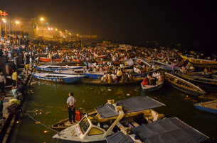 large group of people on boats moored at night on the Ganges at Varanasi, India.の写真素材 [FYI02259916]
