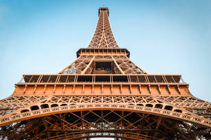 Low angle view of the Eiffel Tower in Paris,  Champs de Mars against a blue sky.の写真素材 [FYI02259968]