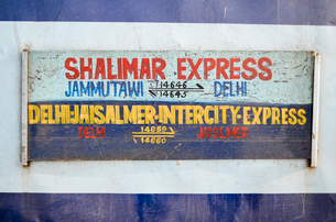 Train journey in Rajasthan, India, directional sign on a train.の写真素材 [FYI02260017]