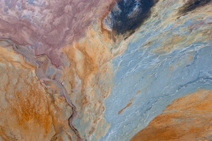 Aerial shot of oxidized iron minerals in water in old mining area.の写真素材 [FYI02260248]