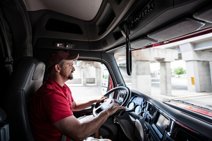 Interior cab view of a Caucasian man driving his  commercial truck.の写真素材 [FYI02260529]