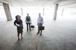 Mixed race team of business people in their new large empty raw office space.の写真素材 [FYI02260543]