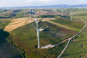 High angle view of rolling landscape with fields and wind turbines.の写真素材 [FYI02260616]