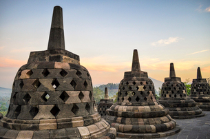 Borobudur temple, a 9th century Buddhist temple with terraces and stupa with latticed exterior, bellの写真素材 [FYI02260804]