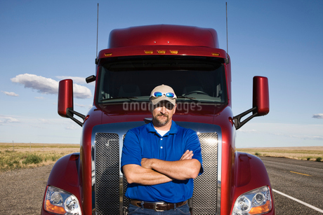 Portrait of a Caucasian man driver and his  commercial truck.の写真素材 [FYI02260846]