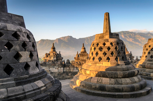 Borobudur temple, a 9th century Buddhist temple with terraces and stupa with latticed exterior, bellの写真素材 [FYI02260906]