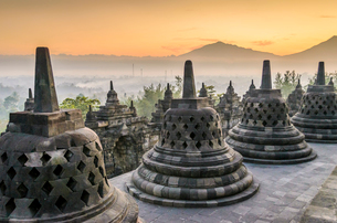 Borobudur temple, a 9th century Buddhist temple with terraces and stupa with latticed exterior, bellの写真素材 [FYI02260932]