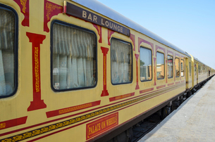 Train carriages in red and yellow livery colours, at a station in Rajasthan. The Palace on Wheels. Bの写真素材 [FYI02260954]