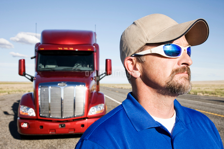 Portrait of a Caucasian man driver and his  commercial truck.の写真素材 [FYI02260969]