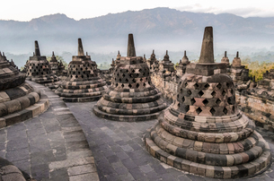 Borobudur temple, a 9th century Buddhist temple with terraces and stupa with latticed exterior, bellの写真素材 [FYI02261033]