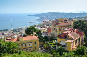 View across the bay of Naples on the coastline of Campania. Historic buildings, and marina and beachの写真素材 [FYI02261062]