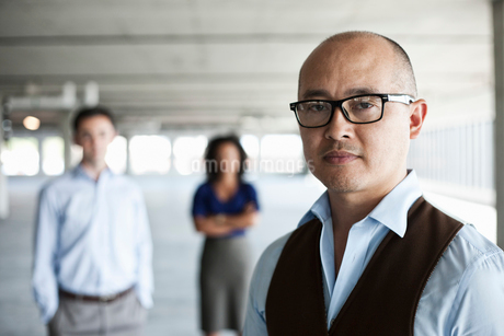 Portrait of a mixed race team of business people in a new empty office space.の写真素材 [FYI02261064]