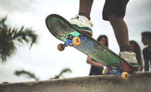 Close up of a skateboard at the top of a skate ramp.の写真素材 [FYI02261175]
