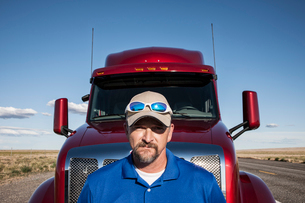 Portrait of a Caucasian man driver and his  commercial truck.の写真素材 [FYI02261187]