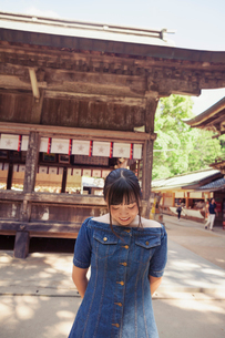 Young woman wearing blue dress standing at Shinto Sakurai Shrine, Fukuoka, Japan.の写真素材 [FYI02261279]