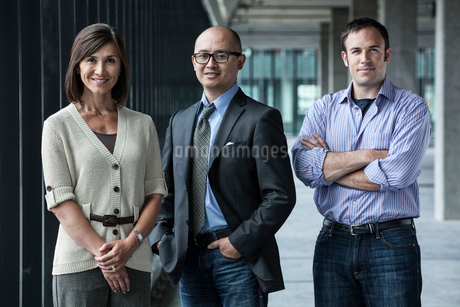 Mixed race team of business people standing in a new office space.の写真素材 [FYI02261318]