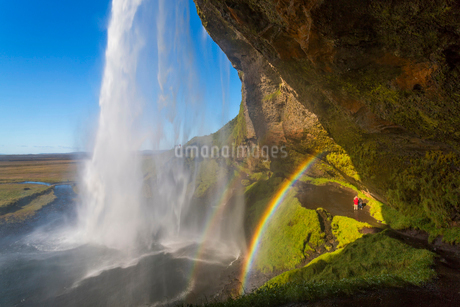 A waterfall cascade over a sheer cliff, a double rainbow in the mist.の写真素材 [FYI02261757]