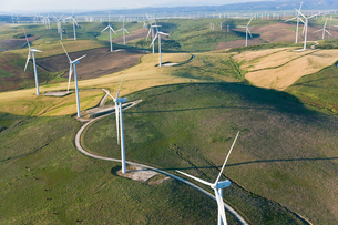 High angle view of rolling landscape with fields and wind turbines.の写真素材 [FYI02261894]