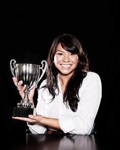 Studio portraits of an Asian woman holding a trophy.の写真素材 [FYI02262363]