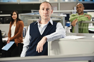 Portrait of a Mixed Race team of three people in an office cubicle setting'の写真素材 [FYI02262517]