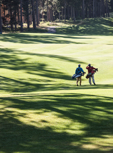 Two golfers surveying the next shot on the fairway.の写真素材 [FYI02262581]