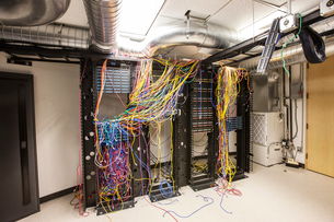 A mess of Cat 5 cables in an office server room.の写真素材 [FYI02262600]