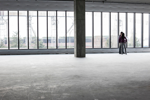 Two architects working on business plans in a new raw business space.の写真素材 [FYI02262606]