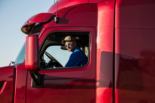 Portrait of a Caucasian man, a truck driver and truck owner.の写真素材 [FYI02262613]