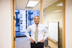 A portrait of a black businessman standing alone in his office space.の写真素材 [FYI02262824]