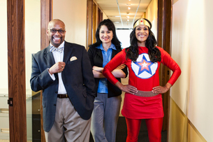 Black woman super hero and her team of mixed race office employees.の写真素材 [FYI02262836]