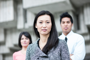 A mixed race team of business people with an Asian businesswoman in the lead.の写真素材 [FYI02262899]