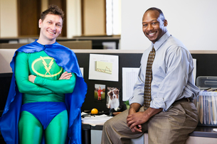 A Caucasian businessman office super hero and his black business man partner.の写真素材 [FYI02263010]