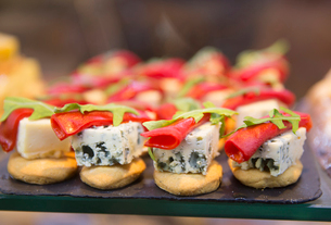 Close up of selection of canapes with blue cheese and garnish.の写真素材 [FYI02263207]