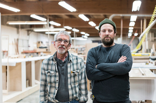 Portrait of two Caucasian carpenters in a large woodworking factory.の写真素材 [FYI02263289]