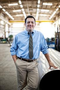 Hispanic man manager in a large sheet metal factory.の写真素材 [FYI02263464]