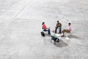 Multi-racial team of people going over plans for a new warehouse interior.の写真素材 [FYI02263505]
