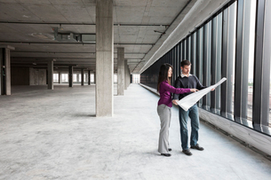 Two architects working on business plans in a new raw business space.の写真素材 [FYI02263527]