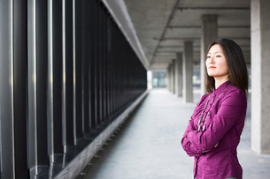 An Asian female business owner in a new raw business space.の写真素材 [FYI02263603]