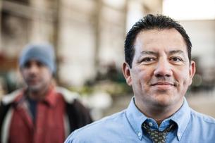 Hispanic man manager in a sheet metal factory.の写真素材 [FYI02263629]