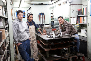 Mixed race team of workers and management people in a large sheet metal factoryの写真素材 [FYI02263645]
