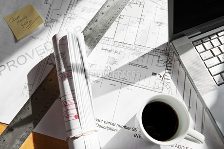 Close-up of blueprints on a desk top in a creative office.の写真素材 [FYI02263759]