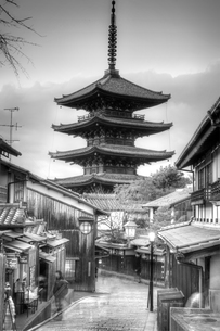 Street lined with traditional buildings with tall wooden pagoda of Buddhist temple in distance.の写真素材 [FYI02263816]