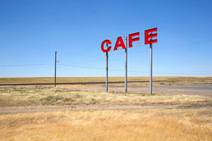Large red capital letters on metal poles advertising cafe in a prairie.の写真素材 [FYI02263821]