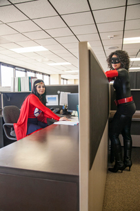 Two women office super hero's in their office.の写真素材 [FYI02263829]